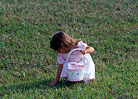 Young girl on Easter egg hunt