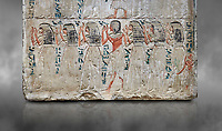 Ancient Egyptian stele of Djehutynefer, treasury Scribe, limestone, New Kingdom, 18th Dynasty, (1480-1400 BC), Thebes,  Egyptian Museum, Turin. Grey background. Old Fund cat 1456.<br /> <br /> The detail of the stele depicts the brothers and sisters of Djehutynefer. The inscription palces the deceased under the protection of Amon in the great temple of Karnak underlining that he is entitled to share offerings brought to the god.