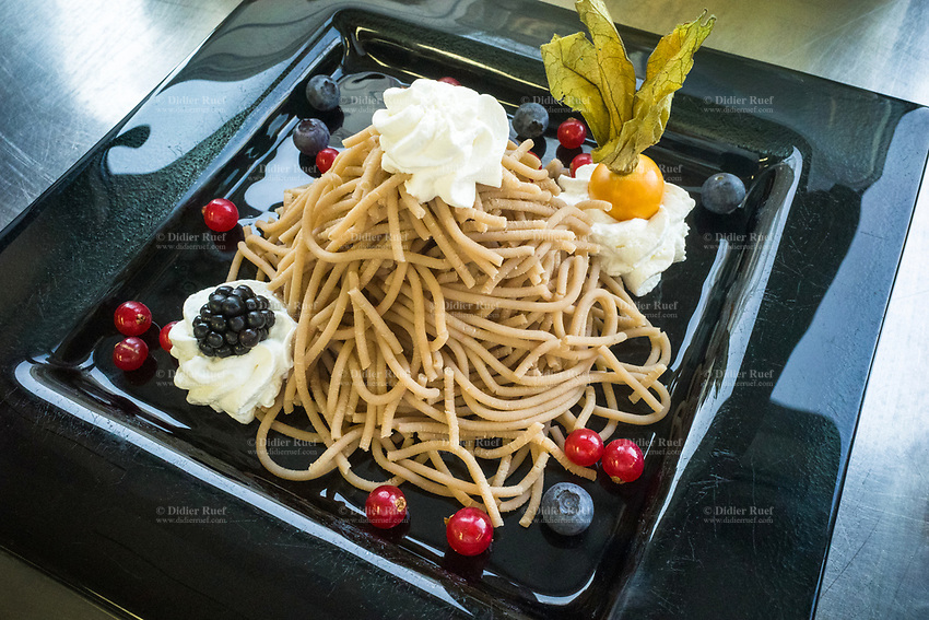 """Switzerland. Canton Ticino. Sorengo. OTAF Foundation. Restaurant. Vermicelli dessert. """"Vermicelli"""", so called in Switzerland in French as well as in German and Italian, is a dessert made from chestnuts,. The chestnut puree is pressed through a pierced surface; filaments are thus obtained which are erected in """"nest"""". The whole is placed on a tart and a meringue, and embellished with whipped cream and fruits. OTAF is a private foundation subsidized by the Ticino canton. For over a century it has been operating in the Ticino area in support of people with disabilities. Sorengo is a municipality in the district of Lugano. 27.01.2020  © 2020 Didier Ruef"""