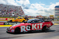 Jul 12, 2020; Clermont, Indiana, USA; NHRA funny car driver Alexis DeJoria (near) races alongside J.R. Todd during the E3 Spark Plugs Nationals at Lucas Oil Raceway. This is the first race back for NHRA since the start of the COVID-19 global pandemic. Mandatory Credit: Mark J. Rebilas-USA TODAY Sports