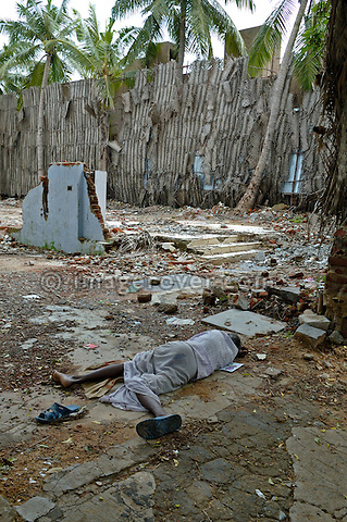 Street person sleeping in the dirt. India, Tamil Nadu, Chennai (Madras), 2005. No releases available.