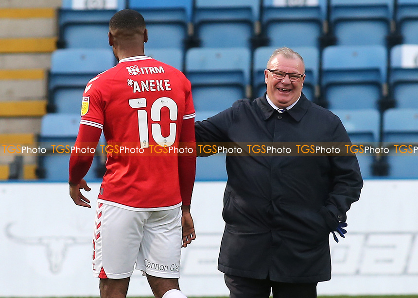 Chuks Aneke, scorer of Charlton's only goal shares a joke with Gillingham Manager, Steve Evans, at the final whistle during Gillingham vs Charlton Athletic, Sky Bet EFL League 1 Football at the MEMS Priestfield Stadium on 21st November 2020