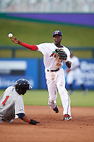 Fort Myers Miracle shortstop Nick Gordon (2) turns a double play as Jose Cuas (1) slides in during a game against the Brevard County Manatees on April 13, 2016 at Hammond Stadium in Fort Myers, Florida.  Fort Myers defeated Brevard County 3-0.  (Mike Janes/Four Seam Images)