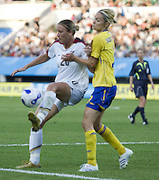 USA forward (20) Abby Wambach and Sweden defender (3) Stina Segerstrom. The USA defeated Sweden 2-0 during their Group B first round game at the 2007 FIFA Women's World Cup at Chengdu Sports Center Stadium in Chengdu, China on September 14, 2007.
