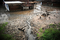 Mud overwhelms the once thriving streets of Besuki village. Since May 2006, more than 10,000 people in the Porong subdistrict of Sidoarjo have been displaced by hot mud flowing from a natural gas well that was being drilled by the oil company Lapindo Brantas. The torrent of mud - up to 125,000 cubic metres per day - continued to flow three years later.