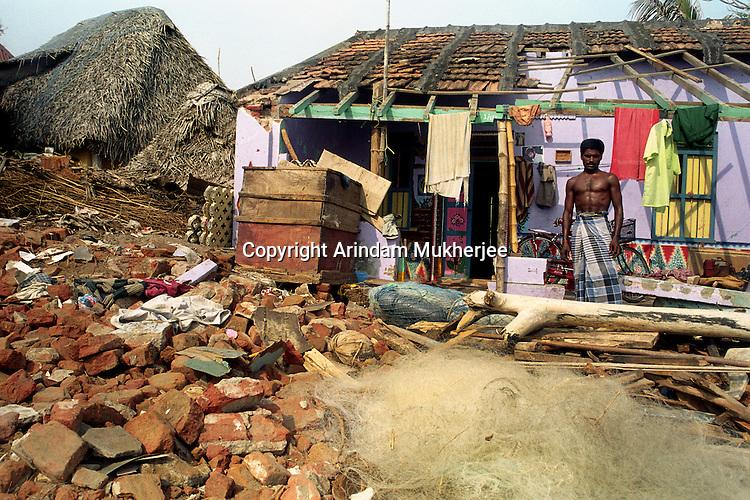 Reclaiming his home and his livelihood.Nagapattinam.India.