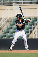 Max Dutto (14) of the Kannapolis Intimidators at bat against the Greensboro Grasshoppers at Intimidators Stadium on July 17, 2016 in Greensboro, North Carolina.  The Intimidators defeated the Grasshoppers 3-2 in game one of a double-header.  (Brian Westerholt/Four Seam Images)