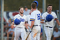 South Dakota State Jackrabbits Braeden Brown (32) greets Landon Badger (left), Ryan McDonald (center) and Colton Cox (right) after a home run during a game against the Northeastern Huskies on February 23, 2019 at North Charlotte Regional Park in Port Charlotte, Florida.  Northeastern defeated South Dakota State 12-9.  (Mike Janes/Four Seam Images)