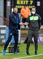 Bolton Wanderers' head coach Ian Evatt (left) conversing with the fourth official<br /> <br /> Photographer Andrew Kearns/CameraSport<br /> <br /> The EFL Sky Bet League Two - Stevenage v Bolton Wanderers - Saturday 21st November 2020 - Lamex Stadium - Stevenage<br /> <br /> World Copyright © 2020 CameraSport. All rights reserved. 43 Linden Ave. Countesthorpe. Leicester. England. LE8 5PG - Tel: +44 (0) 116 277 4147 - admin@camerasport.com - www.camerasport.com