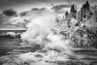 """""""Winter's Final Act""""<br /> The wild waves and freezing spray painted winter along Lake Superior's North Shore. Photographing in these conditions can be challenging. In addition to maintaining stability in the strong winds, spray from huge waves pelts us and our gear, freezing within seconds. Yet, we eagerly head to her shores to witness her power and fury."""