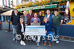 Customers in Jimmy O'Brien bar presents their loose change they were saving in a jar in the bar to Kerry Cancer Support Group at the bar on Monday evening front row l-r: Breda Dyland, Toni Fleming, Linda Daly Back row: Alan Breen, John Looney, Sean Reen, Dan Joe Ahern, Charlie Buckingham, Ciaran Fleming Declan O'Riordan,