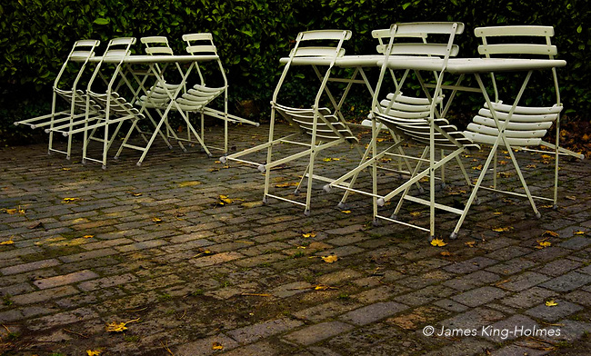 Chairs and tables of a outdoor café at the end of the summer season Chairs and tables of a outdoor café at the end of the tourist season