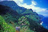 Hikers see the Na Pali Coastline along the Kalalau Trail, Kauai