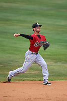 Birmingham Barons second baseman Joey DeMichele (27) throws to first during a game against the Biloxi Shuckers on May 24, 2015 at Joe Davis Stadium in Huntsville, Alabama.  Birmingham defeated Biloxi 6-4 as the Shuckers are playing all games on the road, or neutral sites like their former home in Huntsville, until the teams new stadium is completed.  (Mike Janes/Four Seam Images)