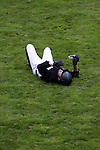 August 09, 2009: Peter Charles (GBR) lies in agony on the ground after falling from his mount Murka's Pall Mall H. Longines International Grand Prix. Failte Ireland Horse Show. The RDS, Dublin, Ireland.