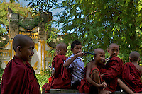 Novice Monks on an old truck playing with a Toy Gun, Village of Kyauk Se near Mandalay, Myanmar