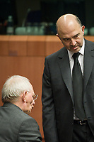 Wolfgang Schauble, German Federal Minister of Finance talks with Pierre Moscovici , EU commissioner for Economic and financial affairs, taxation and customs union at the start of a Eurogroup with European Finance Ministers meeting at EU council headquarters in Brussels, Belgium on 26.01.2015 The Eurogroup's meeting focus on Greece, after  leftist anti-bailout party SYRIZA won parliamentary elections by Wiktor Dabkowski
