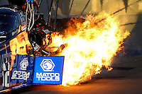 Nov 10, 2013; Pomona, CA, USA; NHRA top fuel dragster driver Antron Brown has a fire in the shutdown area during the Auto Club Finals at Auto Club Raceway at Pomona. Mandatory Credit: Mark J. Rebilas-