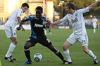 Simon Dawkins (center) controls the ball between Shea Salinas (left) and Jonathan Leathers (25). The San Jose Earthquakes tied the Vancouver Whitecaps 2-2 at Buck Shaw Stadium in Santa Clara, California on July 20th, 2011.