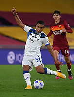 Football, Serie A: AS Roma - Atalanta Olympic stadium, Rome, April 22, 2021. <br /> Atalanta's Luis Muriel (l) in action during the Italian Serie A football match between AS Roma and Atalanta at Rome's Olympic stadium, Rome, on April 22, 2021.  <br /> UPDATE IMAGES PRESS/Isabella Bonotto