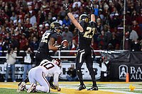 Baylor Bears wide receiver Clay Fuller #23 celebrates touchdown by inside receiver Levi Norwood #42 during second half of NCAA football game at Floyd Casey Stadium in Waco, TX. Baylor defeats Oklahoma 41-12.