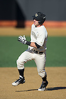 Ben Breazeale (9) of the Wake Forest Demon Deacons hustles towards third base against the Richmond Spiders at David F. Couch Ballpark on March 6, 2016 in Winston-Salem, North Carolina.  The Demon Deacons defeated the Spiders 17-4.  (Brian Westerholt/Four Seam Images)