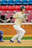 Evan Stephens #5 of the Wake Forest Demon Deacons follows through on his swing against the UNC-Asheville Bulldogs at Wake Forest Baseball Park on February 28, 2012 in Winston-Salem, North Carolina.  The Demon Deacons defeated the Bulldogs 9-8.  (Brian Westerholt/Four Seam Images)