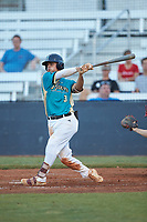 Anthony Hennings (3) (Elon) of the Mooresville Spinners follows through on his swing against the Concord A's at Moor Park on July 31, 2020 in Mooresville, NC. The Spinners defeated the Athletics 6-3 in a game called after 6 innings due to rain. (Brian Westerholt/Four Seam Images)
