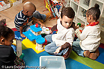 Education preschool 2-4 year olds group of children playing separately with toys horizontal