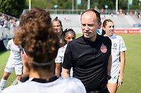 CARY, NC - SEPTEMBER 12: Portland Thorns head coach Mark Parsons speaks with his team before a game between Portland Thorns FC and North Carolina Courage at WakeMed Soccer Park on September 12, 2021 in Cary, North Carolina.
