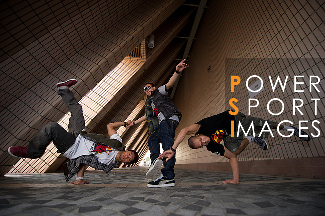 B-Boys Taisuke, Ronnie and Lilou strike a pose on Hong Kong's Victoria Harbour waterfront.