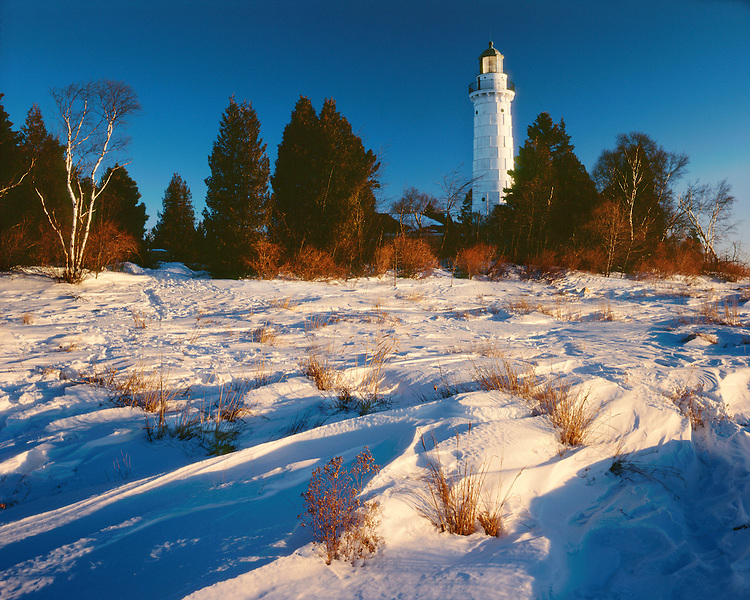 Sunrise light on the lighthouse on Cana Island in Door County, WI