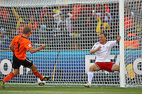 Dirk Kuyt of Holland scores his sides second goal against Denmark..