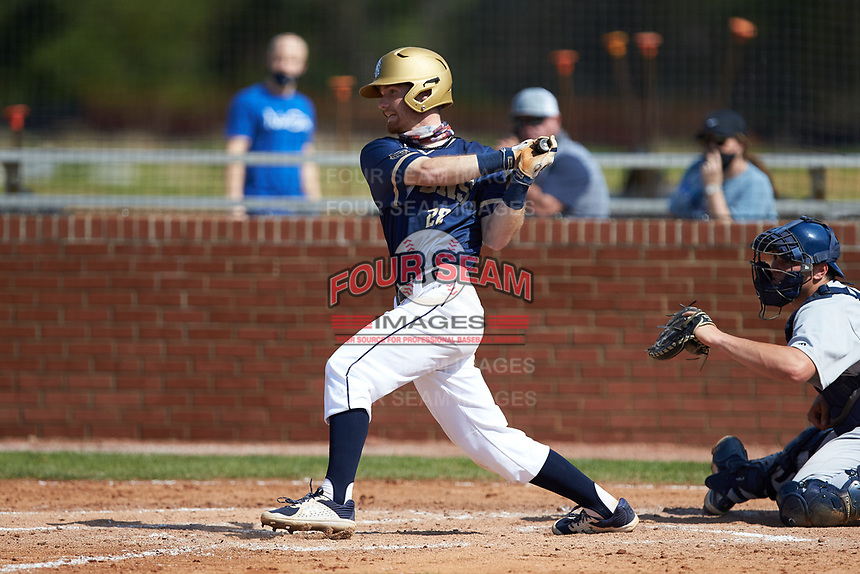 Nick Melton (28) of the Queens Royals at bat during game two of a double-header against the Catawba Indians at Tuckaseegee Dream Fields on March 26, 2021 in Kannapolis, North Carolina. (Brian Westerholt/Four Seam Images)