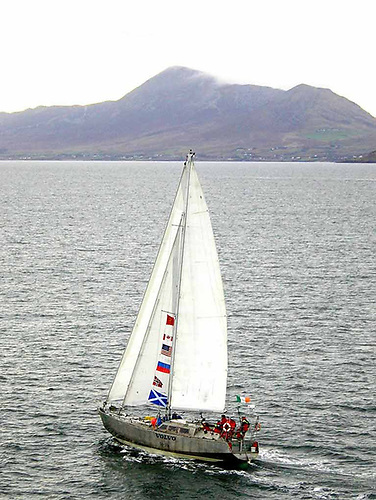 The contrast in Sailor of the Year winning boat types – Arctic circumnavigator Northabout (Jarlath Cunnane & Paddy Barry) returns to Clew Bay and the benign presence of Croagh Patrick in October 2005