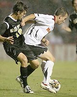 Jason Herrick #9 of the University of Maryland shields the ball from Evan Brown #18 of Wake Forest University during an ACC men's soccer match at Ludwig Field, University of Maryland on September 26 2008 in College Park, Maryland. Wake Forest won 4-2 in front of a record sold out crowd of 6,500.