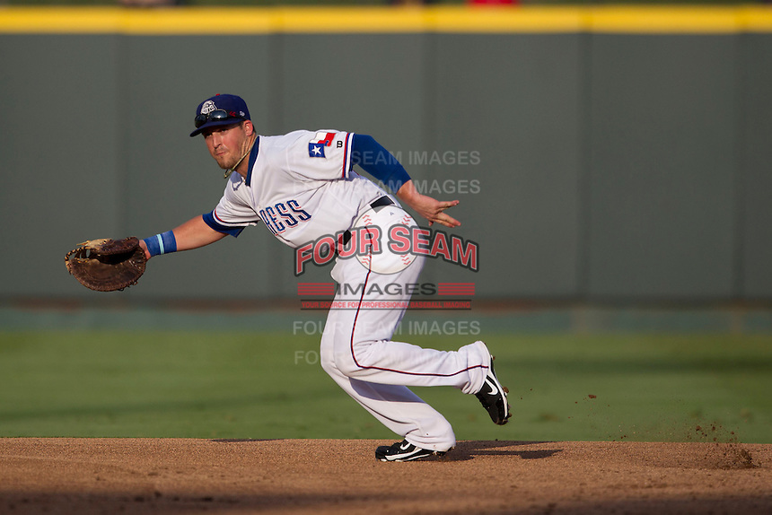 Round Rock Express first baseman Chris McGuiness (21) on defense during the Pacific Coast League baseball game against the Salt Lake Bees on August 10, 2013 at the Dell Diamond in Round Rock, Texas. Round Rock defeated Salt Lake 9-6. (Andrew Woolley/Four Seam Images)