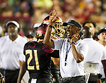 Florida State head coach Willie Taggart directs his team in the 2nd half against Virginia Tech in an NCAA college football game in Tallahassee, Fla., Monday, Sept. 3, 2018. Virginia Tech defeated Florida State 24-3. (AP Photo/Mark Wallheiser)