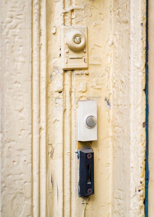 Doorbell buzzers at an apartment door.