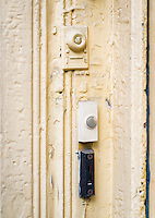 Doorbell buzzers at an apartment door.