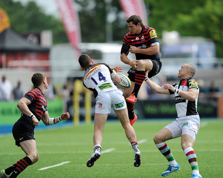 Alex Goode of Saracens fumbles the high ball as Tom Williams and Mike Brown of Harlequins put him under pressure during the Aviva Premiership semi final match between Saracens and Harlequins at Allianz Park on Saturday 17th May 2014 (Photo by Rob Munro)