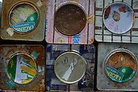 Stack of rusting metal tins, Maldives.