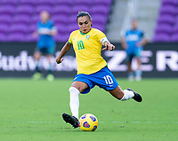ORLANDO, FL - FEBRUARY 18: Marta #10 of Brazil crosses the ball during a game between Argentina and Brazil at Exploria Stadium on February 18, 2021 in Orlando, Florida.