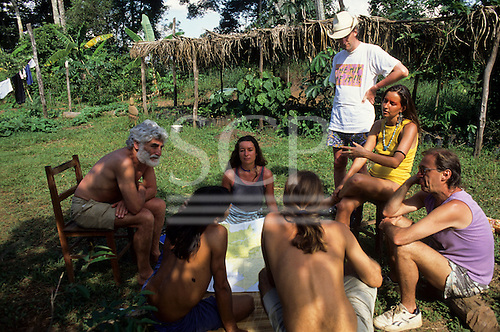 Mato Grosso, Brazil. Ed Posey, Liz Hosken, May East, Kenny Young, Mario Friedlander, Peter looking at a map, Chapada dos Guimaraes, 1990.