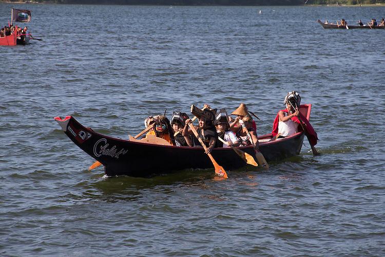 Canoe Journey, Paddle to Nisqually, 2016, Northwest tribal canoes Hoh Tribe, Hoh Canoe, arriving in Olympia, Washington, 7-30-2016, Salish Sea, Puget Sound, Washington State, USA,