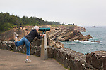 Rocky viewpoint with telesscope overlooking the Pacific Ocean from Cape Arago on the central coast of the state of Oregon, USA.