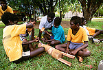 Youths with a project in wood-carving class, Tiwi people, Bathurst Island, Australia