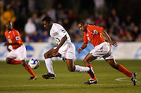 Virginia Tech Hokies midfielder Scott Spangler (8) chases Wake Forest Demon Deacons midfielder Michael Lahoud (13) during an NCAA College Cup semi-final match at SAS Stadium in Cary, NC on December 14, 2007. Wake Forest defeated Virginia Tech 2-0.