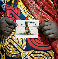In a photograph Ramata Modou, 58, holds a meal of ground red maize, white rice and crushed mango leaves. This will be the only food she and her six children will eat today. It was gathered by begging from house to house in a village near the IDP camp where they live and where Ramata is the appointed leader. <br />  <br /> During an attack on her village, on the border with Nigeria, Ramata Modou's husband suffered a heart attack and her 17 year old daughter and grandchild were taken. Following the attack Ramata and her children, aged from five to 16 years old, fled their village, eventually arriving in Meme, where, for the first two months, they all slept under trees. <br /> <br /> Ramata says: 'When the fighters came into the village, my husband started shaking and trembling. He was holding his head. When they arrived, one man was standing at the door with a gun. Another one put his leg on my mattress and the other one was pulling my daughter. My daughter was screaming and I was screaming, but they didn't hit me. Leaving my village was very difficult. We used to own cattle and sheep, but we had to leave all of those things behind. We had no choice, we had to leave. Even the roofs of some of the houses have now been stolen.'