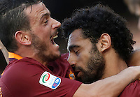 Calcio, Serie A: Napoli vs Roma. Napoli, stadio San Paolo, 15 ottobre. <br /> Roma Mohamed Salah, right, celebrates with teammate Alessandro Florenzi after scoring during the Italian Serie A football match between Napoli and Roma at Naples' San Paolo stadium, 15 October 2016. Roma won 3-1.<br /> UPDATE IMAGES PRESS/Isabella Bonotto